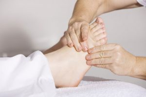 masaje de pies a cabeza